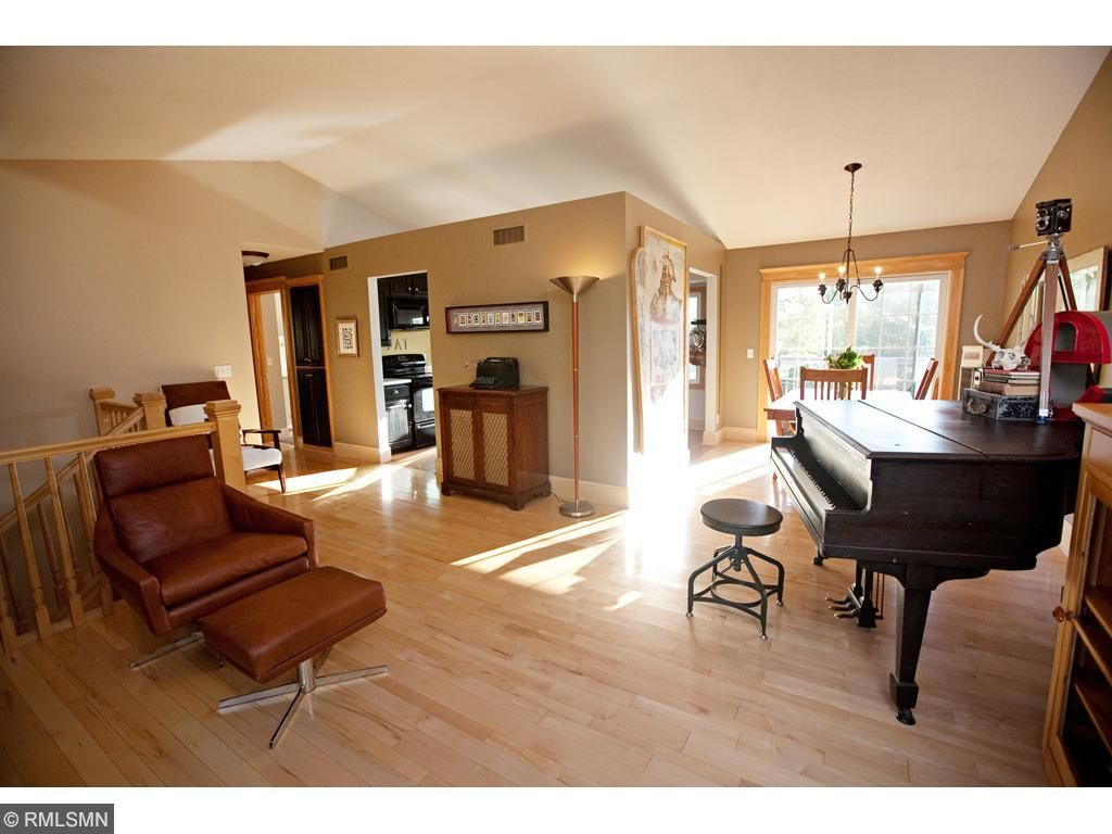 Another view of the living room with it's great vaulted ceilings and natural light.