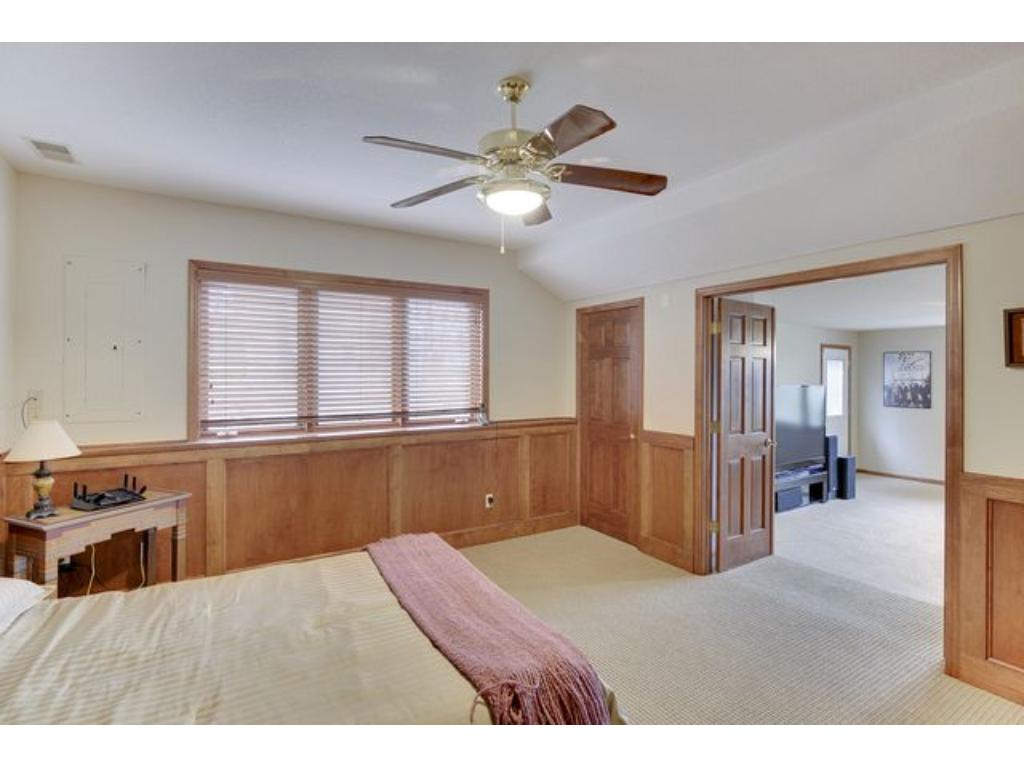 Lower level bedroom leads to media area