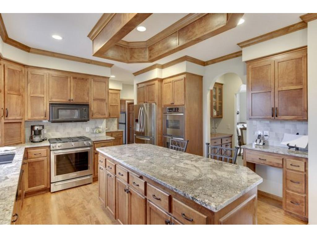 Kitchen leads to private office and main floor laundry...