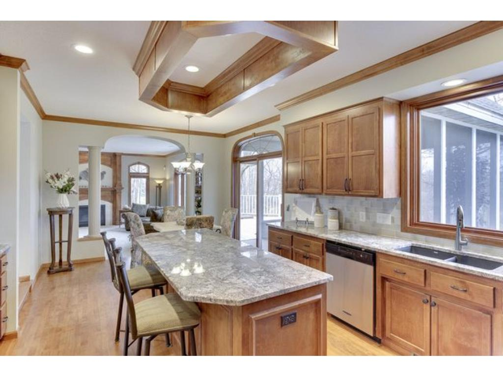 ...and kitchen is also open to screen porch and comfortable family room