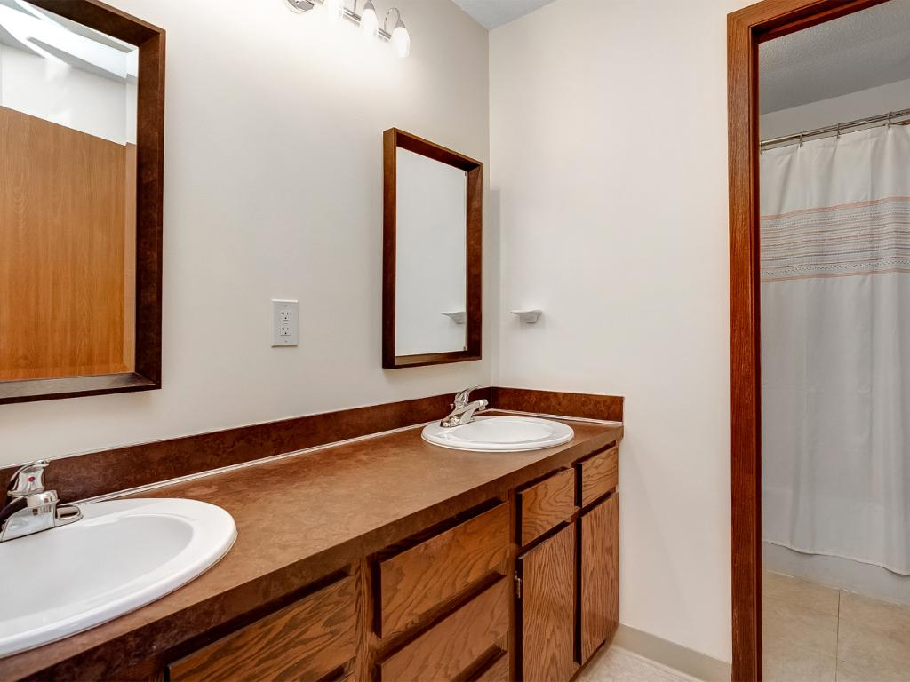 Bathroom with double bowl vanity and separate space for shower and toilet!