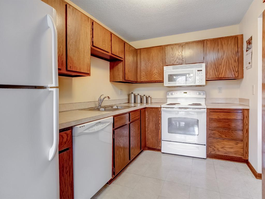 Nice kitchen with plenty of cabinet and counter space.