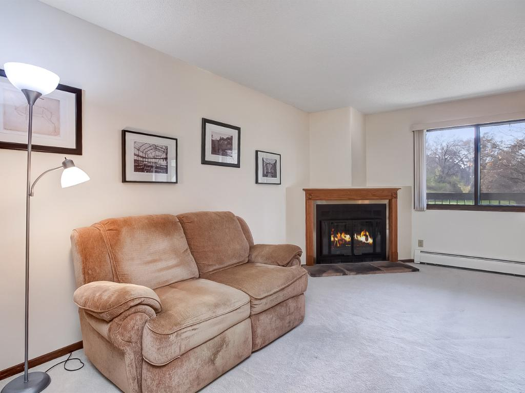Living room with oak surround on fireplace and stone tile hearth!