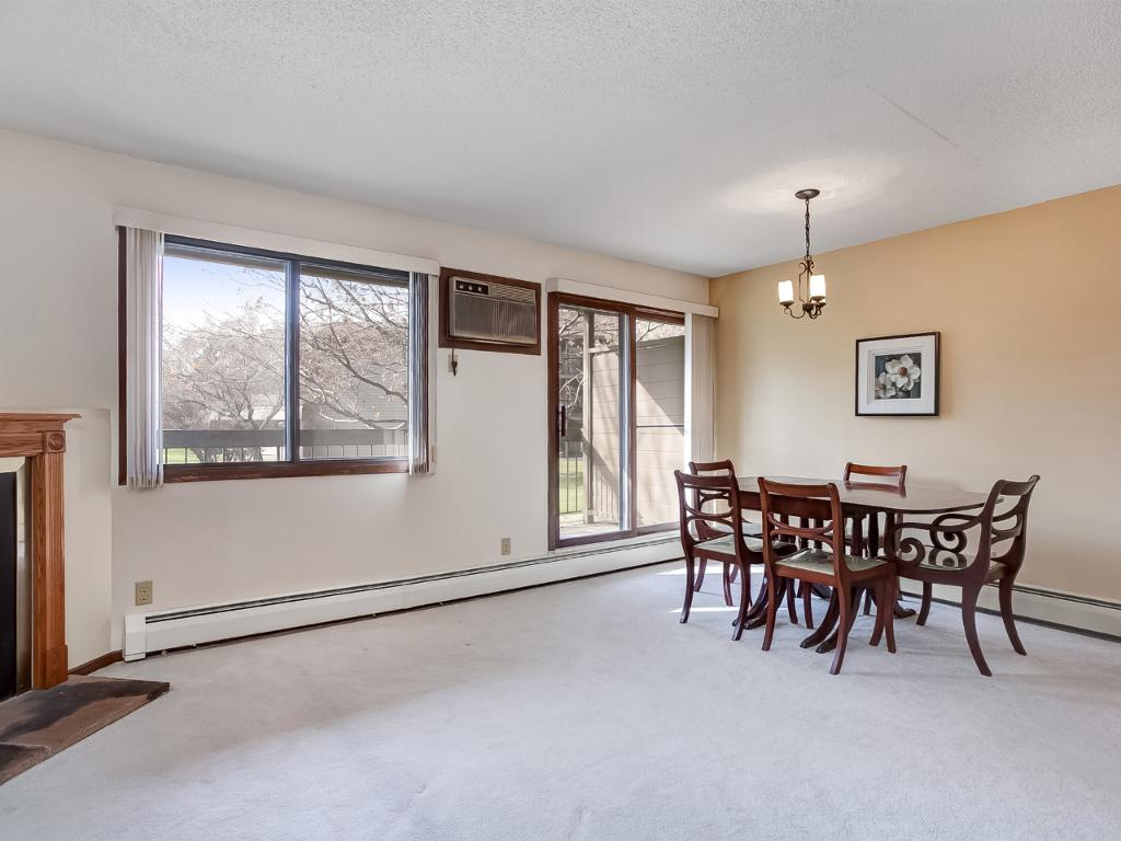 Living and Dining Room spaces blend easily with access to deck off of dining room.  Deck runs the entire length of the rooms!