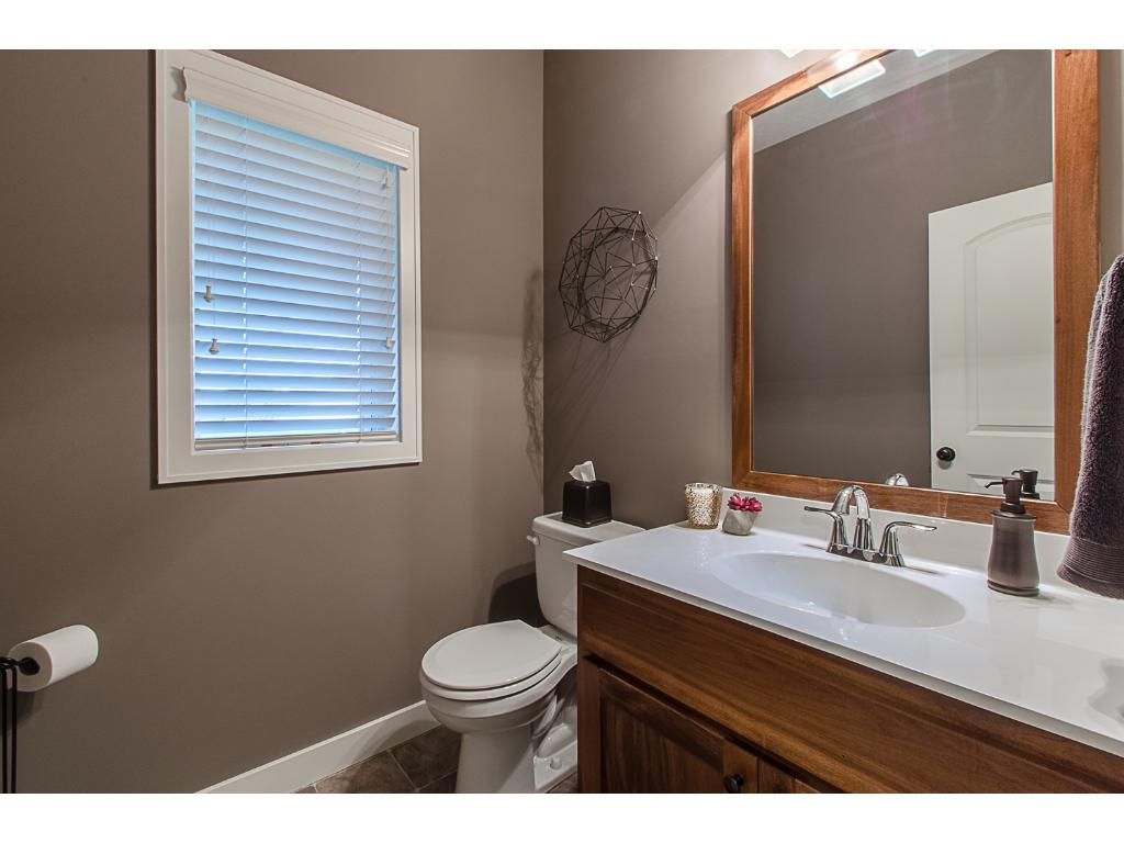 Main floor powder room is conveniently located off the mudroom