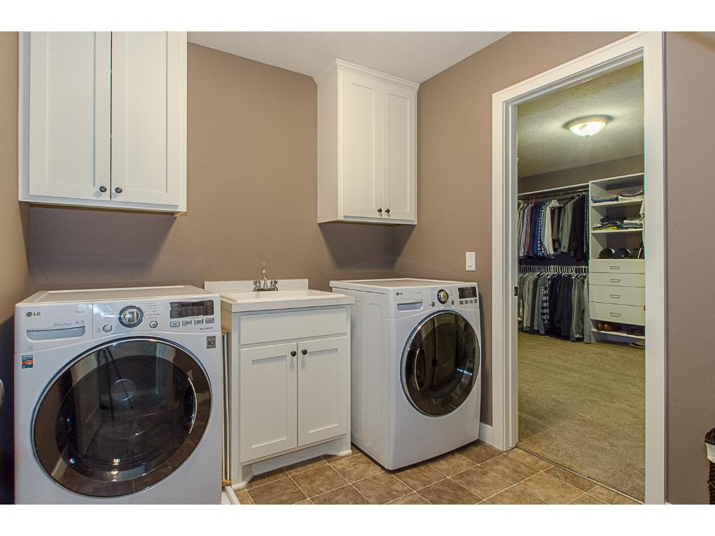 The laundry room is conveniently located on the upper level- no need to haul dirty clothes downstairs only to haul them back up again! Laundry sink and storage are icing on the cake.