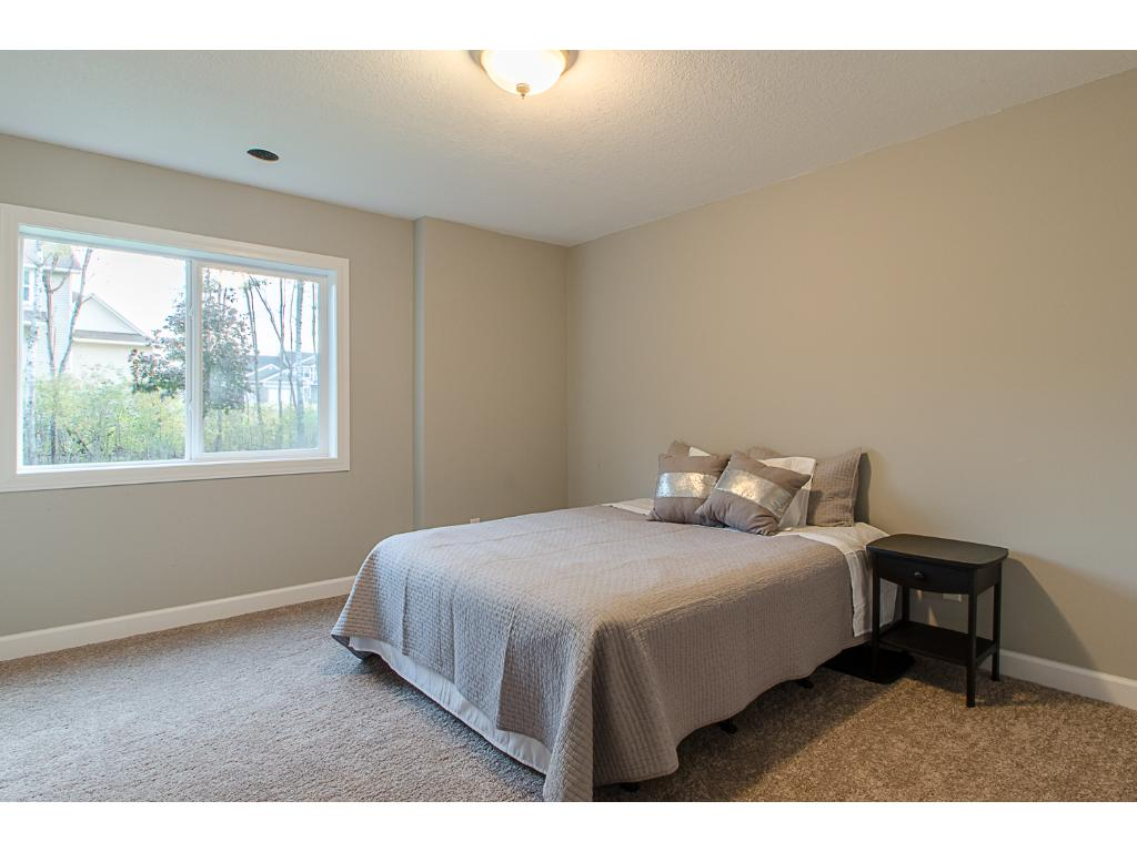 Newly finished lower level bedroom is a perfect place for guests or teenagers!