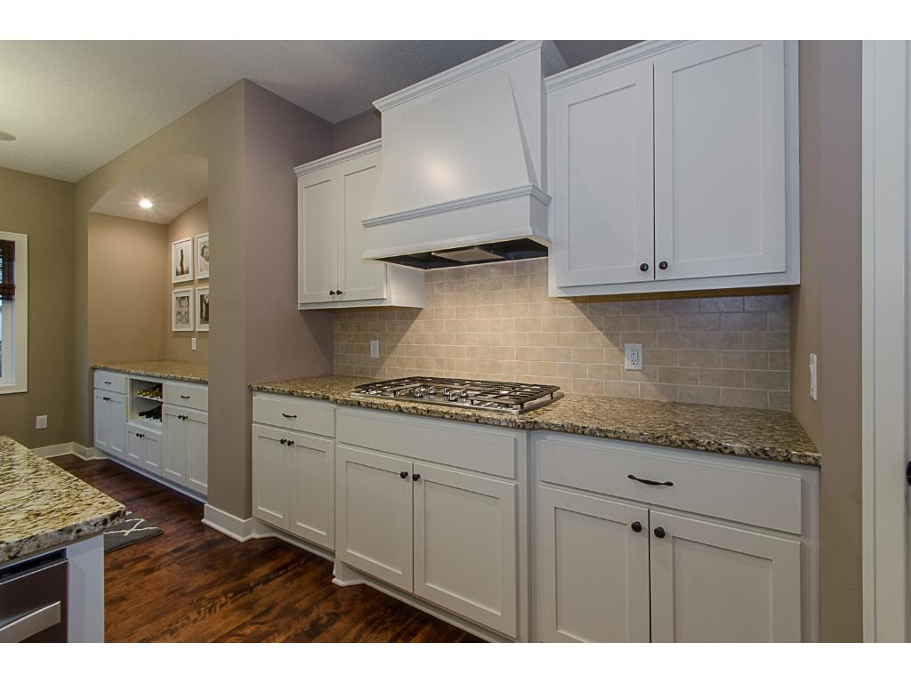 The five-burner gas cooktop and dedicated vent hood will bring out the gourmet chef in anyone!