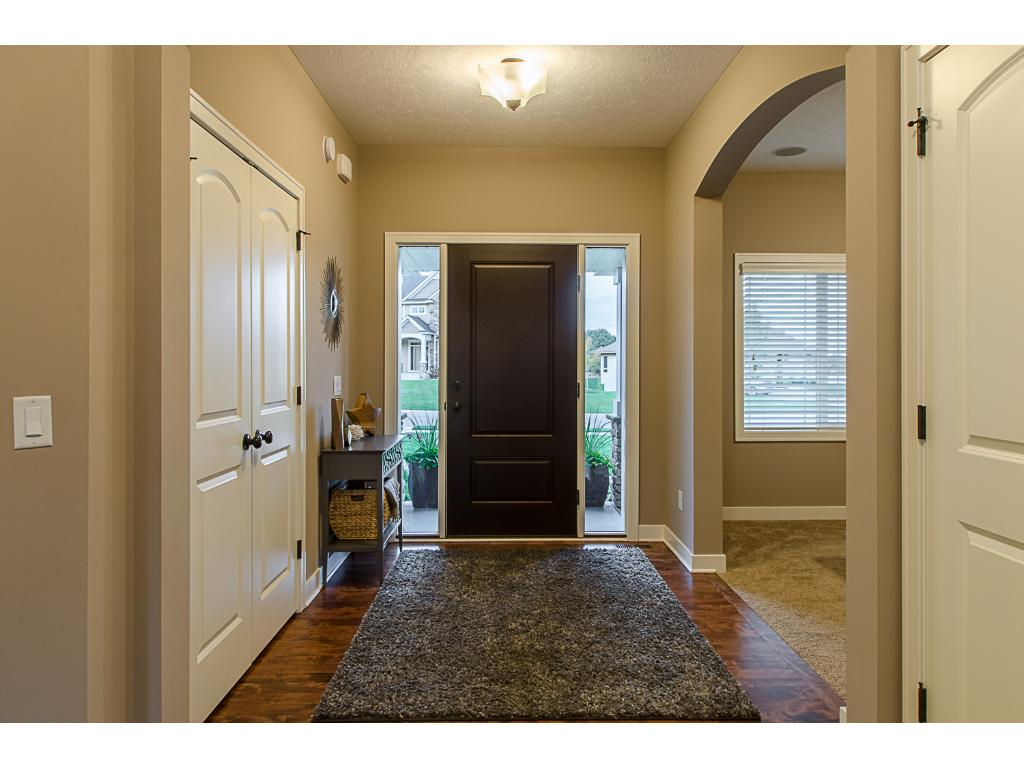 A double-door closet in the front entry is big enough for everyone's coats and boots!  Notice the touches such as arched doorways and two-panel doors...