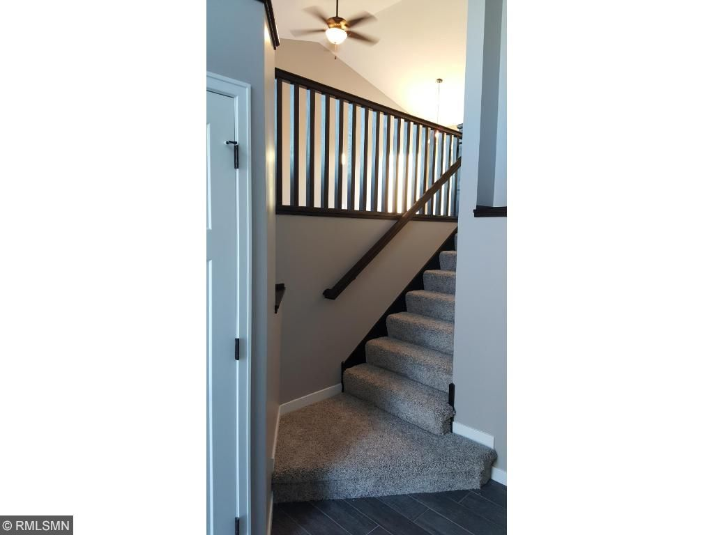 Bright entry foyer with porcelain tile floor and build in shelves.