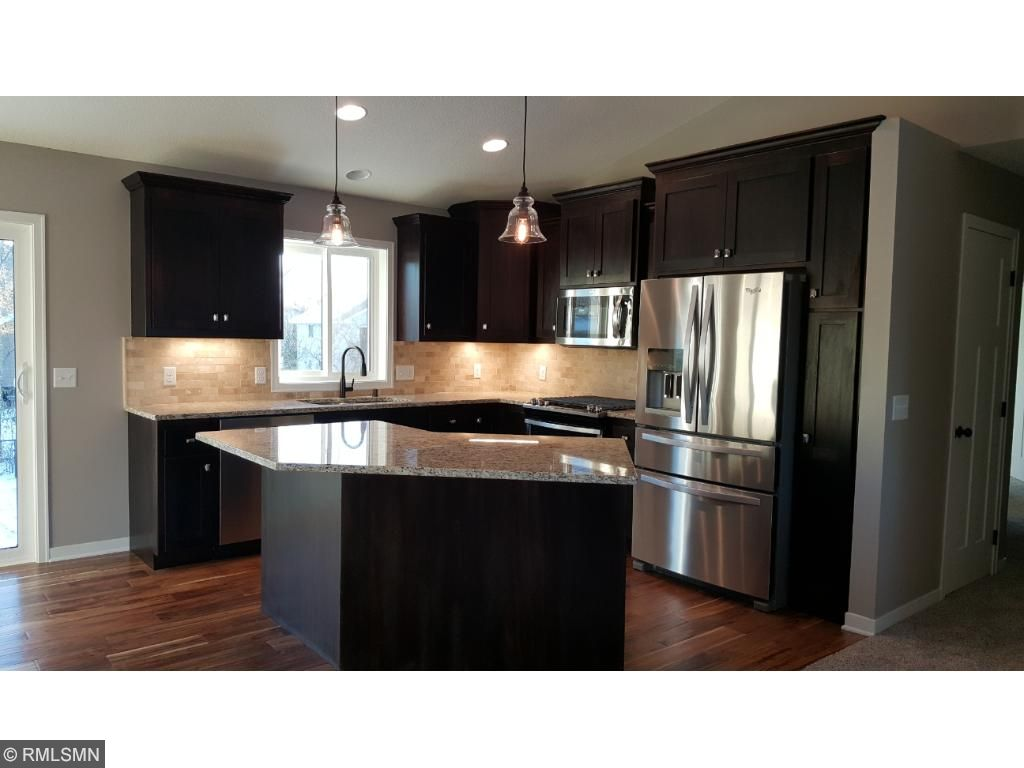 A closer look at the stainless appliances, granite counter-tops and tiled back splash.