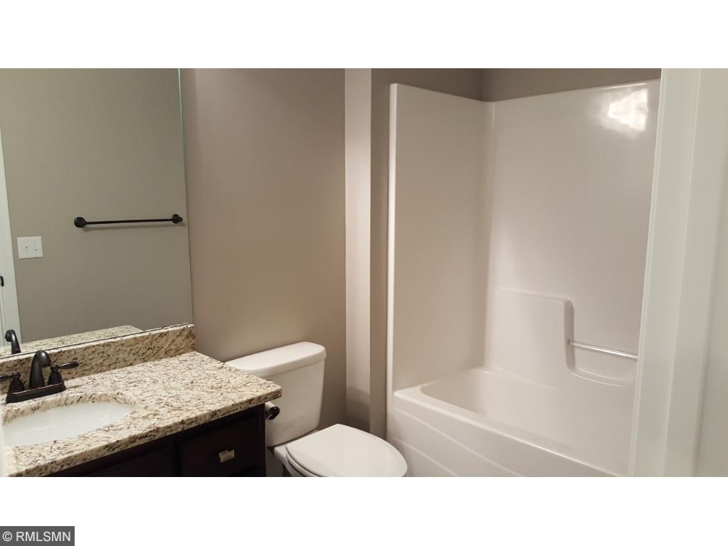 Second bathroom on main level with granite top, soft close doors and drawers, tile floor - full bath