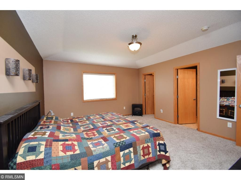 Spacious master bedroom with tray vault ceiling, large walk-in closet and full master bath with jet tub.