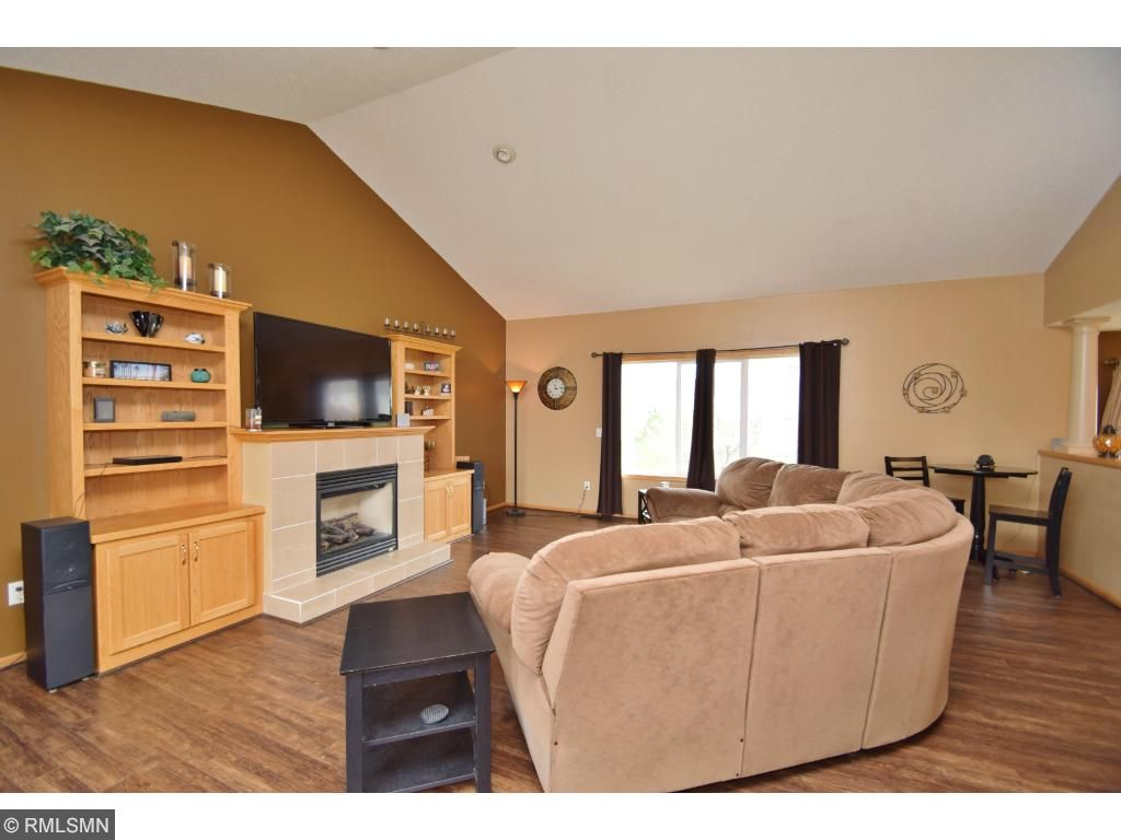 Gorgeous, light, open great room with gas fireplace and built-in shelving, newer flooring and fresh paint.