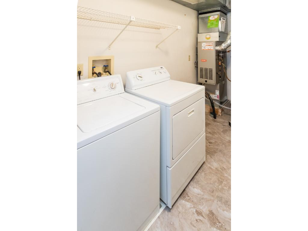 Laundry room with additional storage opportunitiesl