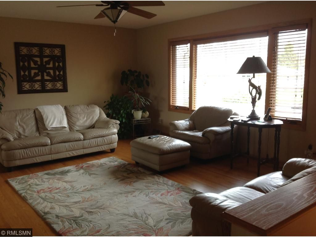 Light, bright living room. Hardwood flooring and newer windows throughout upper level.