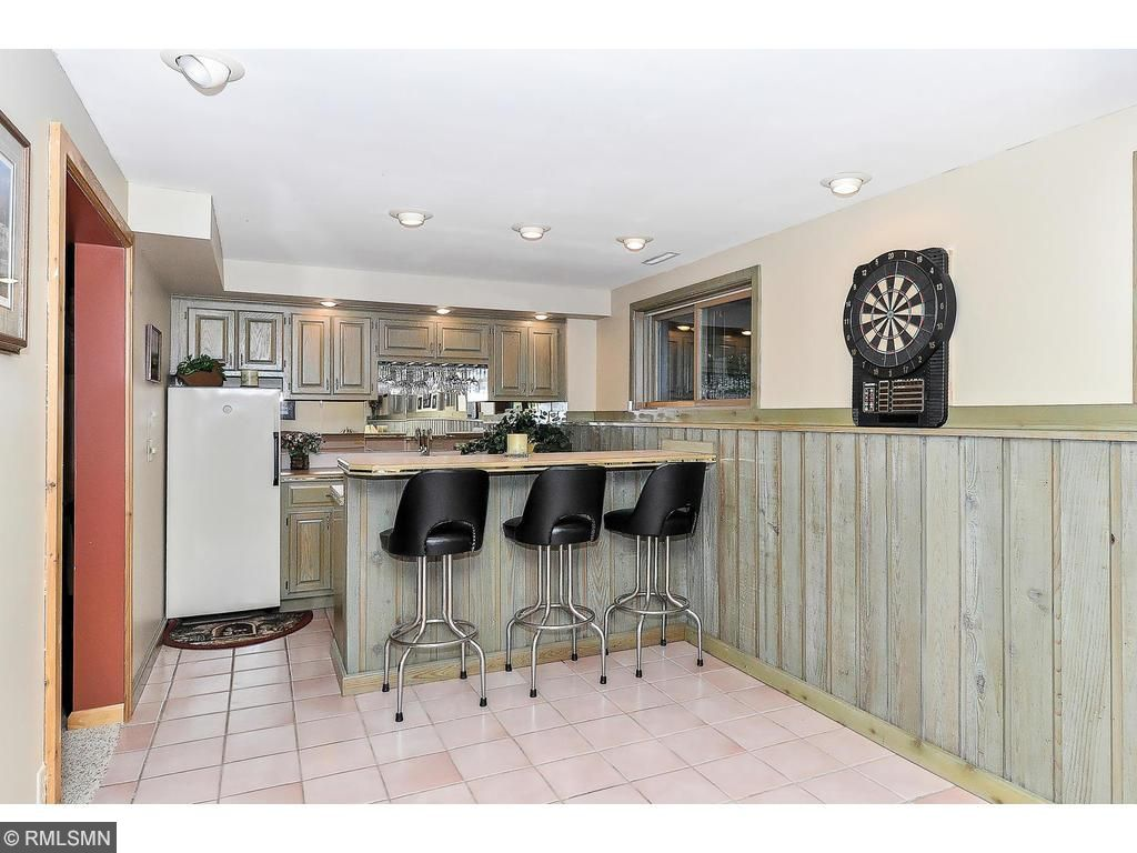 Wet bar opens to the  amusement room for entertaining or watching the Big game.