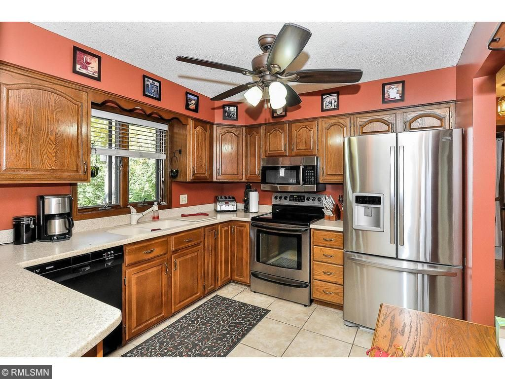 Kitchen has updated appliances, breakfast bar, and pantry with ample storage space.