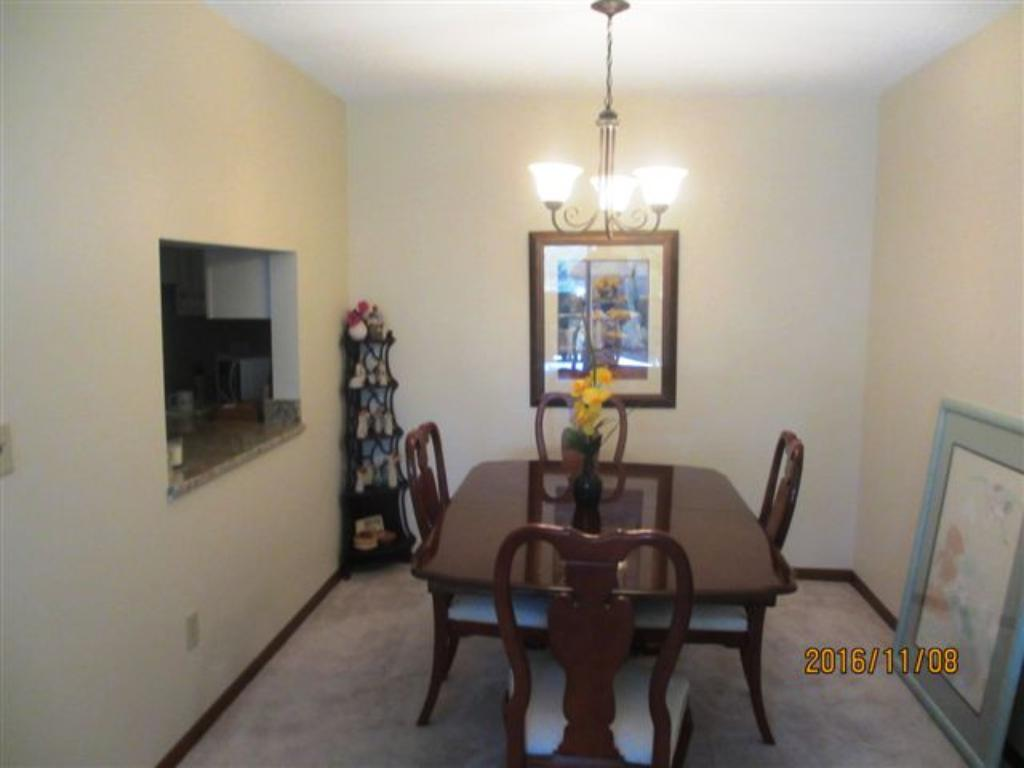 Dining room that can seat10 to 12 with pass thru from the kitchen.