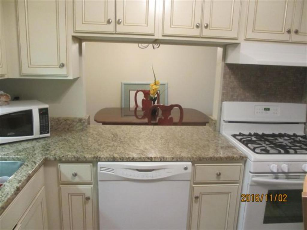 Newer kitchen with newer appliances and granite counter tops.