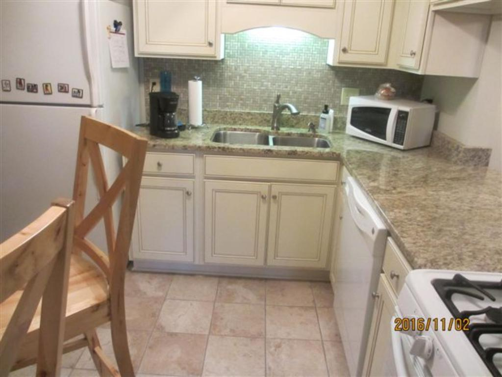 Nice eat-in your spacious kitchen with newer cupboards.