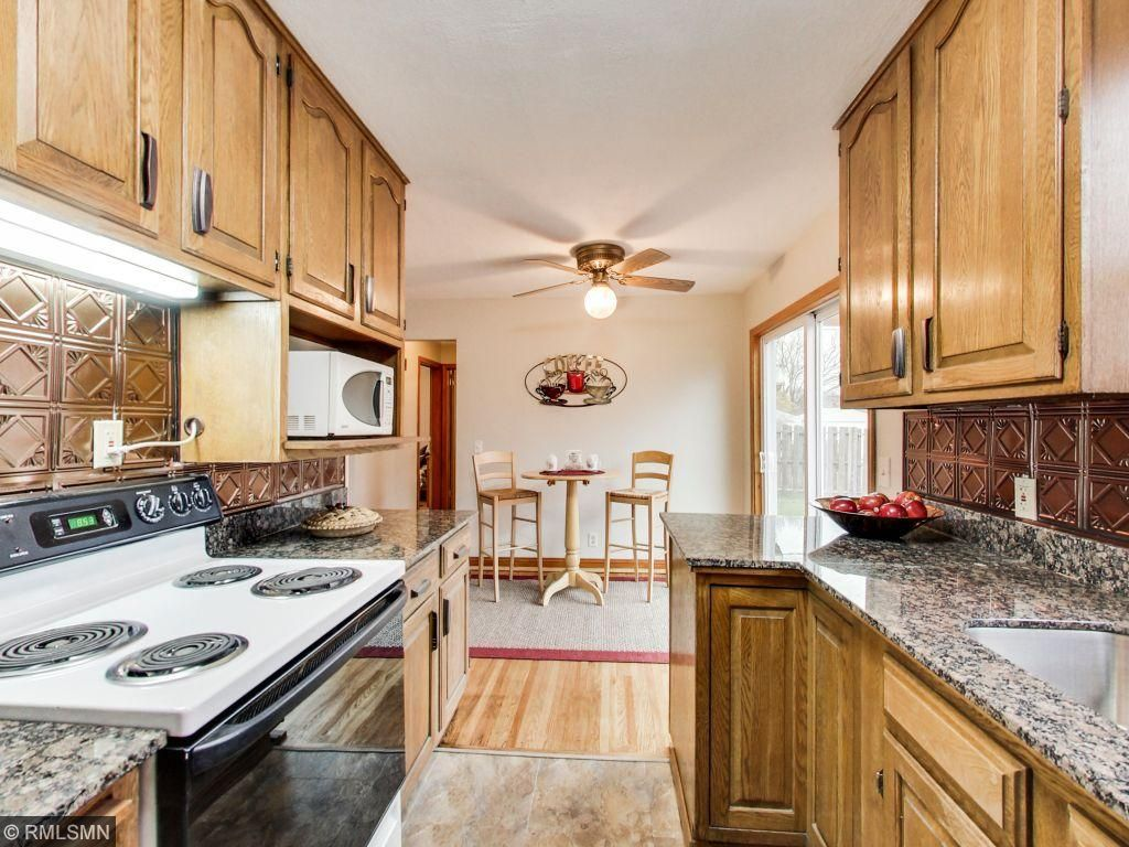 New granite counter tops in kitchen and plenty of storage options in solid wood cabinets and matching hardware.