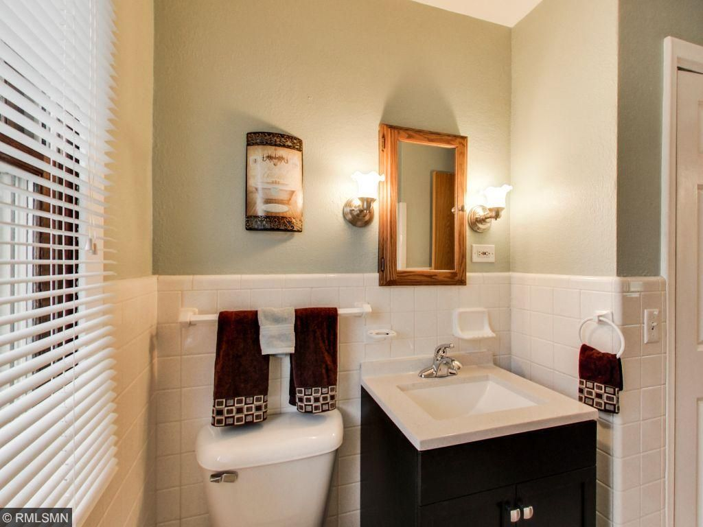Stylish vinyl tile flooring in bathroom and kitchen and fresh paint colors throughout leaves you with a turn key home.