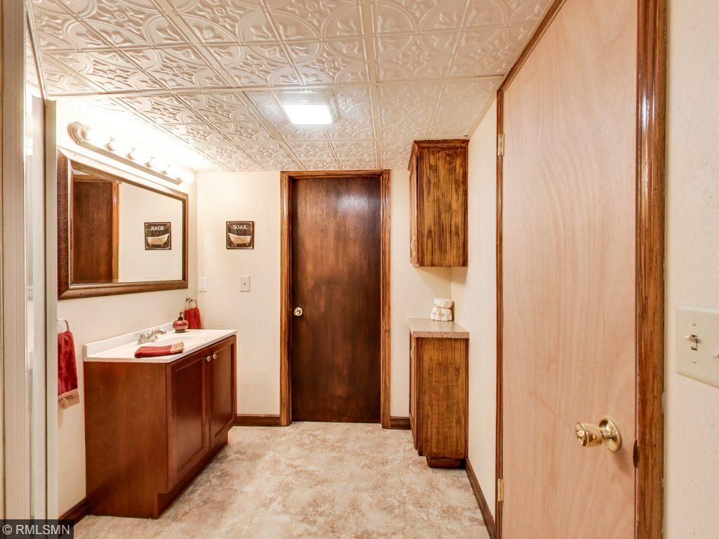 Lower level bathroom. Large storage closet and connects to laundry room.