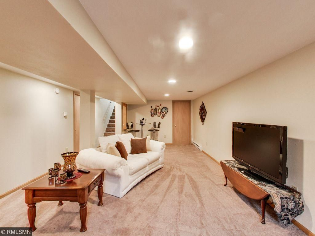 Lower level family room with egress window. New carpet through-out lower level and upper bedrooms.