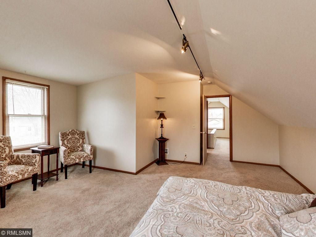 Large bedroom on upper level with sitting window bench.