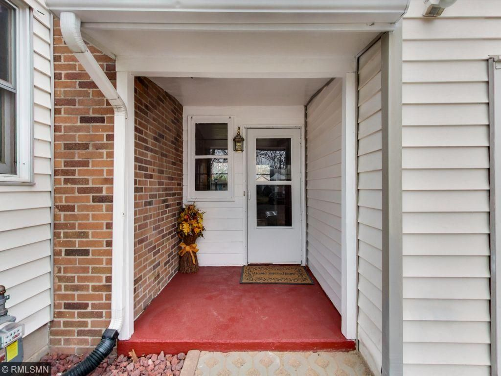 Another front entry into the breezeway area that also leads to lower level family room, bathroom and laundry.