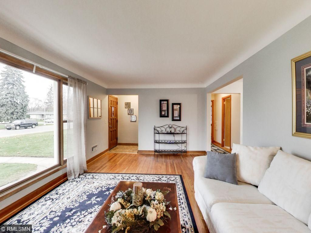 Beautiful refinished original wood floors and new carpet throughout the home. Front living room offers a large window illuminating natural light and wood burning fireplace.