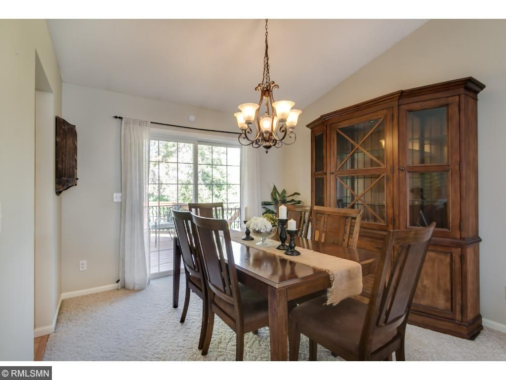 The Formal Dining Area is Spacious and Bright with a Sliding Glass Door Leading Outside