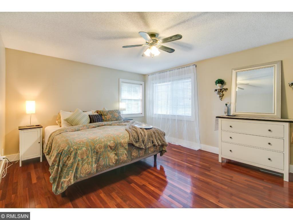 Large Master Bedroom with Hardwood Floors.