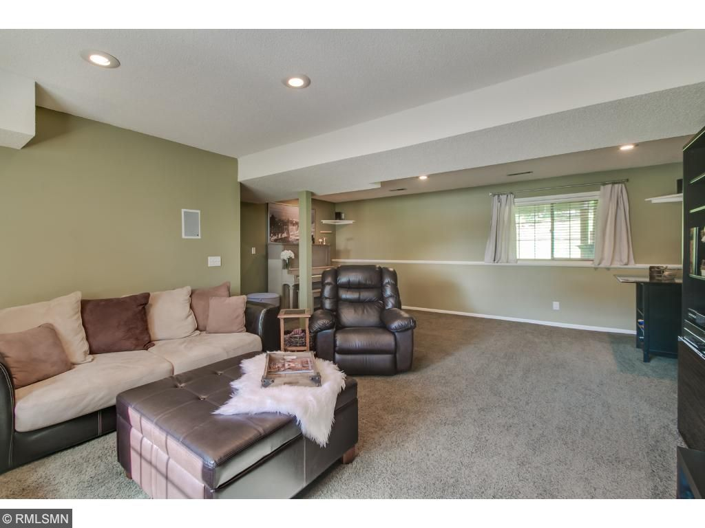 Spacious Family Room with Cozy Gas Fireplace and Surround Sound Built In/Wired In Thru Out.