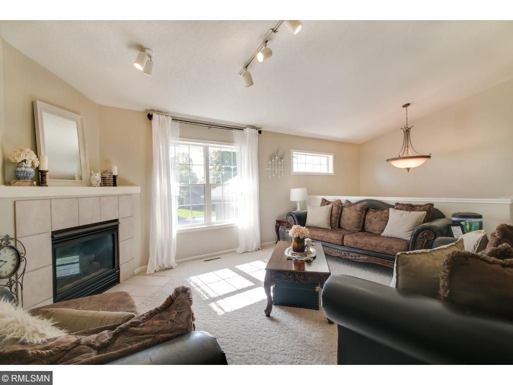 Kick Back and Relax in the Living Room which Boasts a Warm Ambiance and is Centered around a Stylish Gas Fireplace