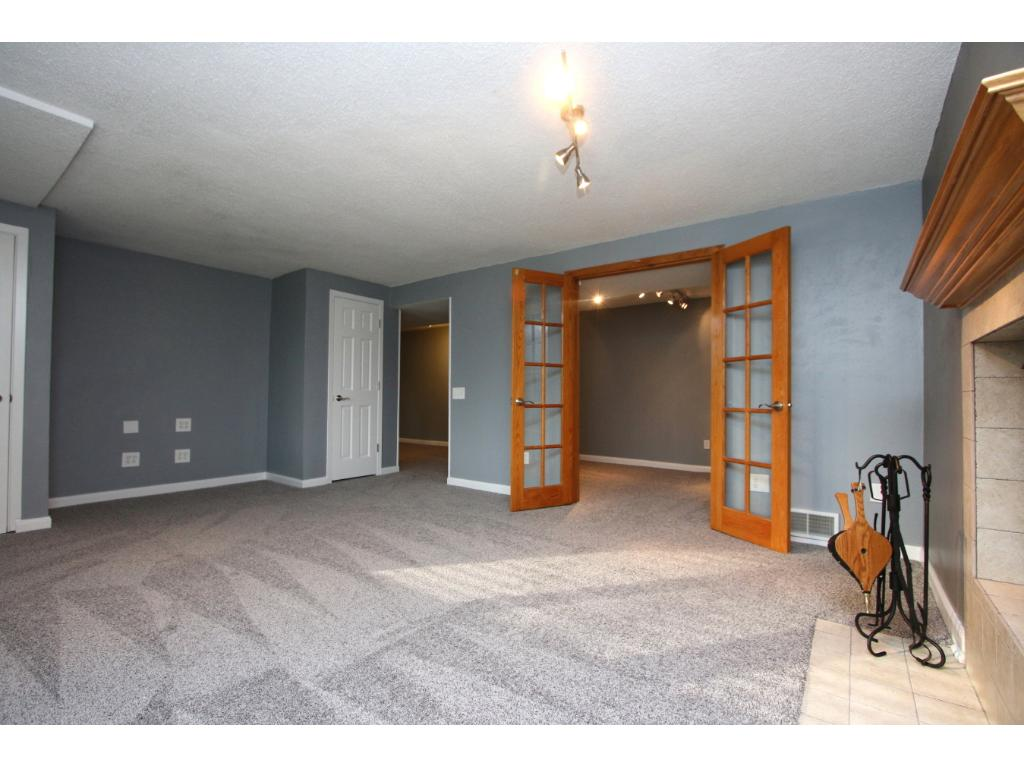 French doors lead from family room to 4th bedroom/den that includes an egress window.  Note, this room does not have a closet.