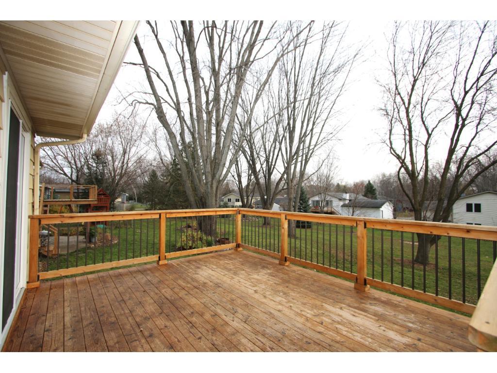 Deck overlooking backyard and association park space.