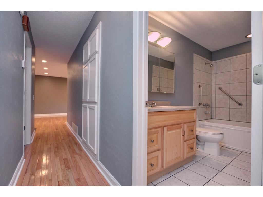 Main level hall way to 3 bedrooms and updated bathroom with whirlpool tub.