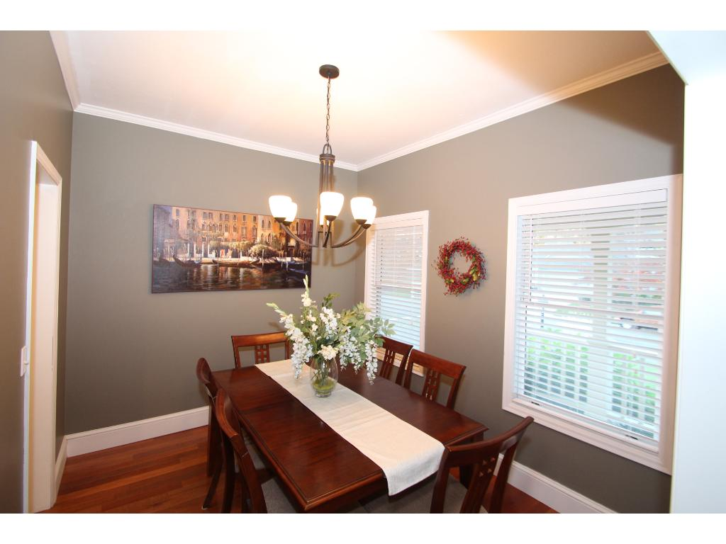 Formal dining room with large windows.