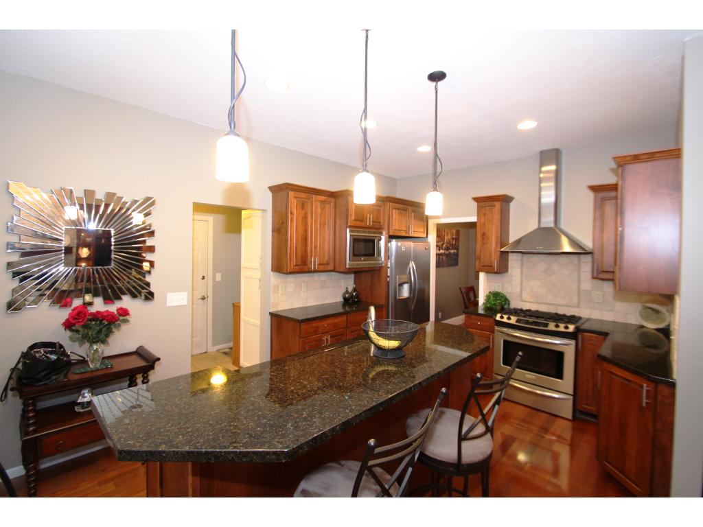 Nicely updated kitchen with granite countertops and stainless appliances.