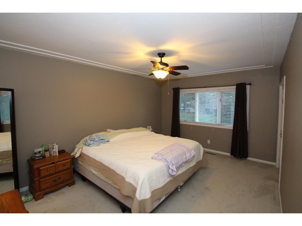 Main floor master bedroom features racetrack ceiling detail