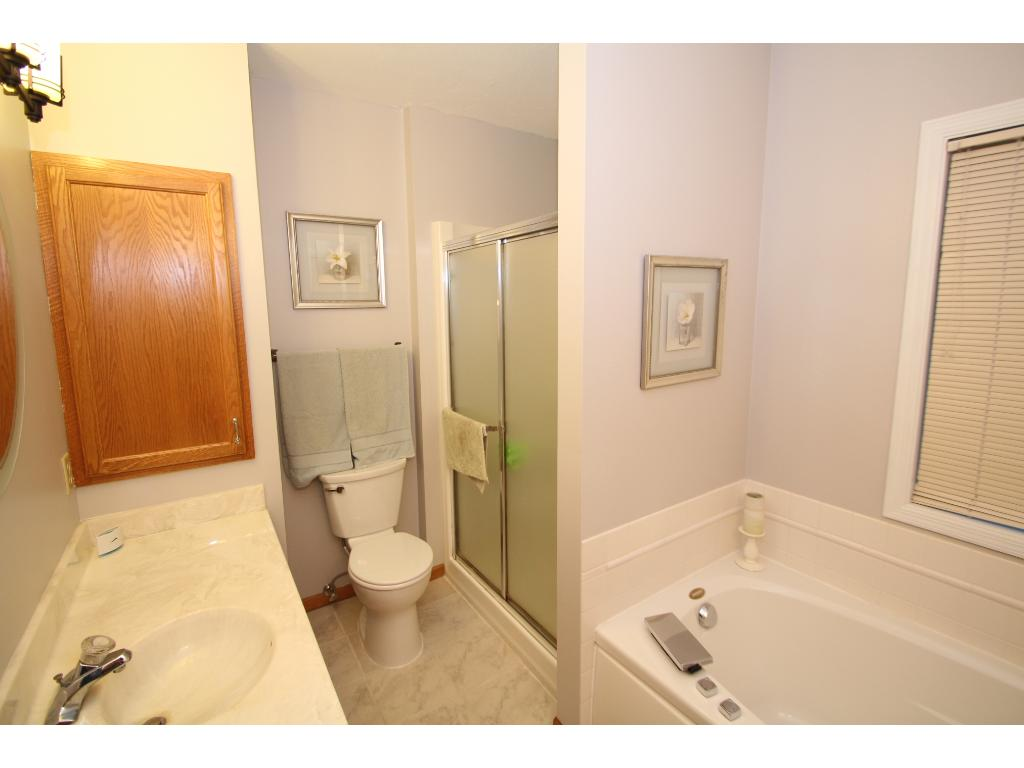 Master bath also features separate tub and shower.