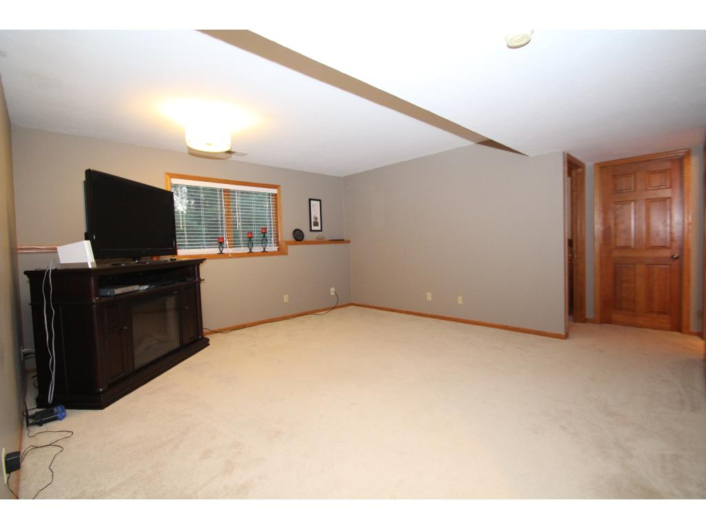 Lower level family room with lookout windows.