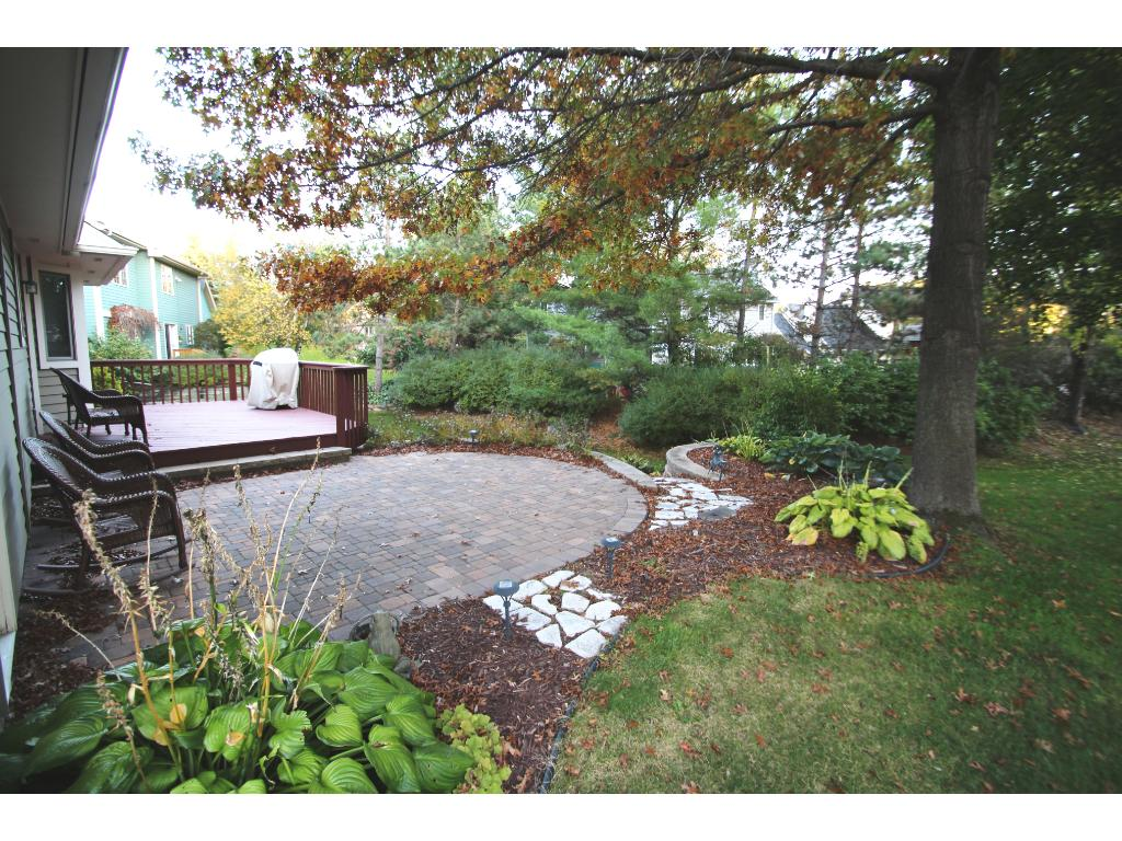 Beautiful landscaping with paver patio and deck