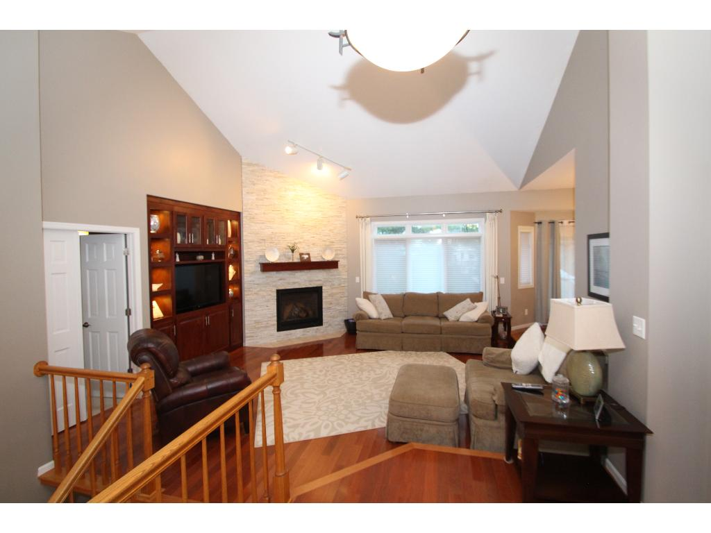 View as you enter the home.  Notice the open layout and tall vaulted ceiling.