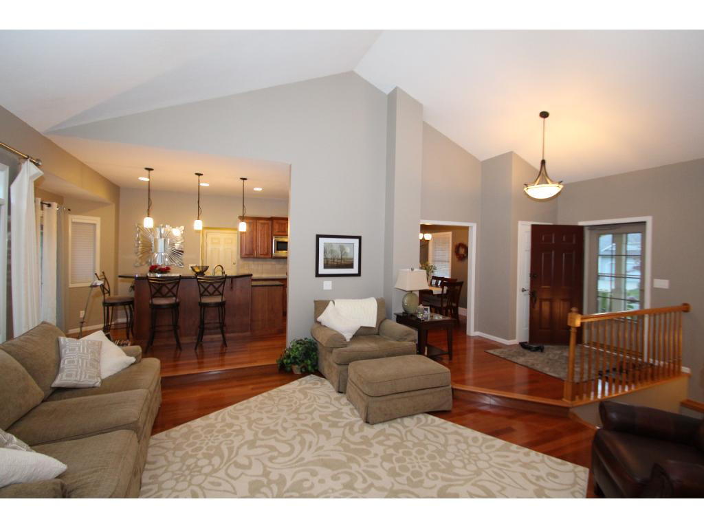 Open layout to kitchen and formal dining.