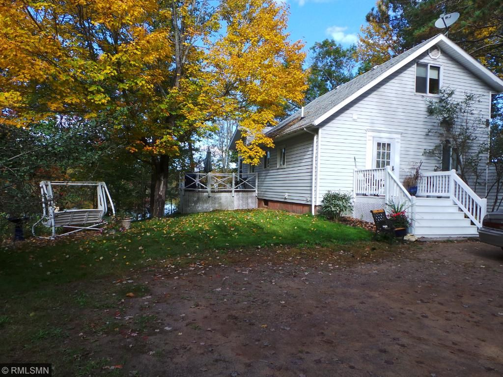 Simply beautiful this fall with stunning colors and warm weather.  Don't miss this opportunity to own a wooded lake lot with a large home and privacy on 2.21 acres!
