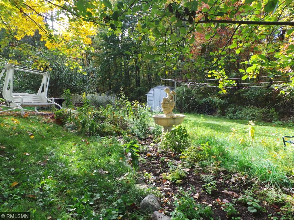 Surrounded by forest and nestled along the shore of Long Lake. Yard offers flower garden, apple tree and a fenced garden area.