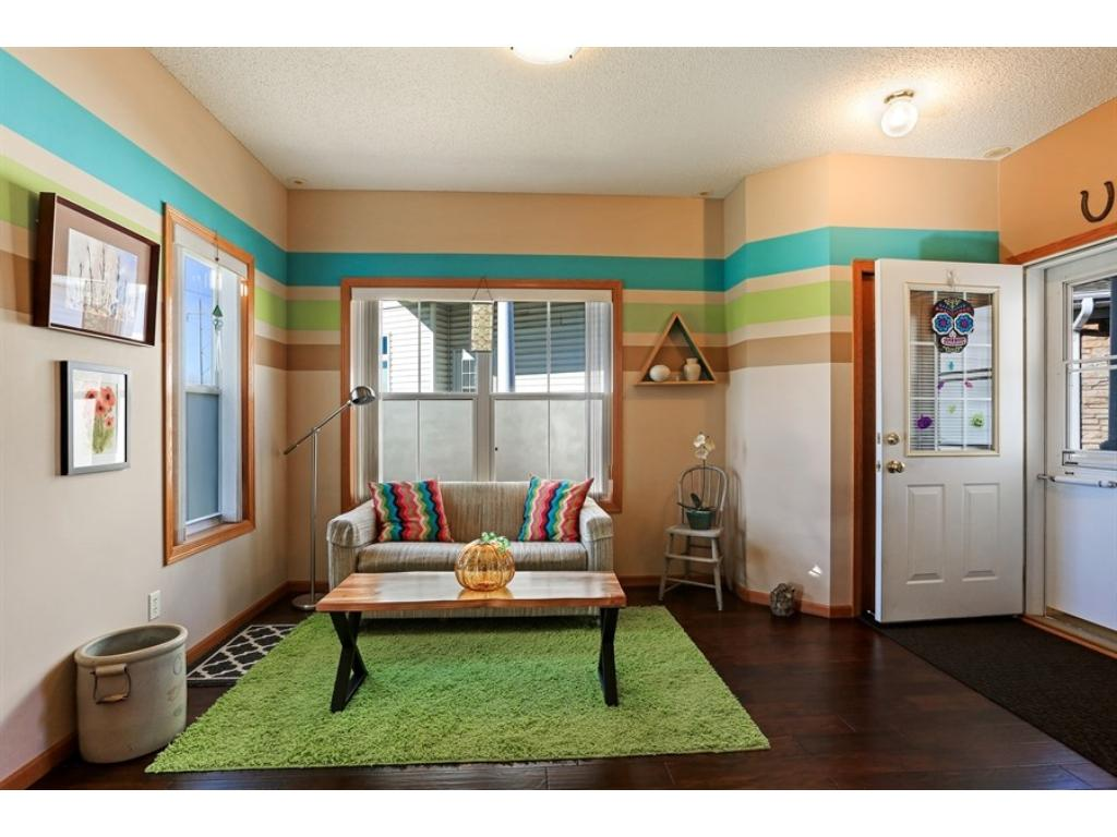Sitting area, dining area or entry space - wonderfully decorated and move in ready!